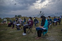 Kashmiri students attend an open-air early morning class inside Eidgah, a ground reserved for Eid prayers, in Srinagar, Indian controlled Kashmir, on July 18, 2020. (AP Photo/Dar Yasin)