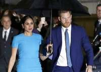 Prince Harry and Meghan, the Duke and Duchess of Sussex arrive at the annual Endeavour Fund Awards in London on March 5, 2020. (AP Photo/Kirsty Wigglesworth)