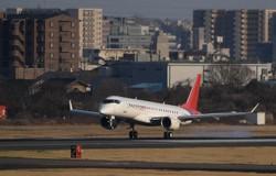 試験飛行を終え名古屋空港に着陸するスペースジェット=2020年3月18日、兵藤公治撮影