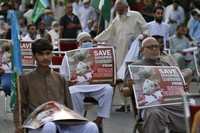 Supporters of a religious group Jamaat-e-Islami take part in a rally to show solidarity with Kashmiri people on the eve of first anniversary of India's decision to revoke the disputed region's semi-autonomy, in Islamabad, Pakistan, on Aug. 5, 2020. (AP Photo/Anjum Naveed)