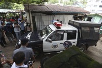 A police vehicle carrying Canadian pastor David Lah leaves a township court after a hearing on Aug. 6, 2020, in Yangon, Myanmar. (AP Photo/Thein Zaw)