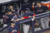 Boston Red Sox's Xander Bogaerts (2) celebrates with teammates in the dugout after hitting a fifth-inning solo home run in a baseball game against the New York Yankees on Aug. 2, 2020, at Yankee Stadium in New York. (AP Photo/Kathy Willens)