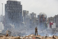 A soldier stands at the devastated site of the explosion in the port of Beirut, Lebanon, on Aug. 6, 2020. (AP Photo/Thibault Camus)