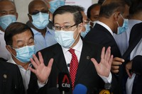Former finance minister Lim Guan Eng speaks to reporters outside a court house in Kuala Lumpur, Malaysia, on Aug. 7, 2020. (AP Photo/Vincent Thian)