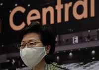 Hong Kong Chief Executive Carrie Lam listens to reporters' questions during a press conference in Hong Kong, on Aug. 7, 2020. (AP Photo/Vincent Yu)