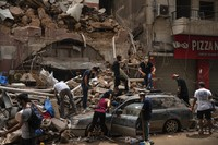 People remove debris from a house damaged by explosion in the seaport of Beirut, Lebanon, on Aug. 7, 2020.  (AP Photo/Felipe Dana)