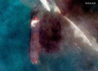 In this satellite image provided by 2020 Maxar Technologies on Aug. 7, 2020, an aerial view of oil leaking from the MV Wakashio, a bulk carrier ship that recently ran aground off the southeast coast of Mauritius. (2020 Maxar Technologies via AP)