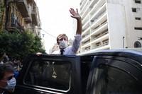 French President Emmanuel Macron waves as he visits Beirut, Lebanon, on Aug. 6, 2020. (AP Photo/Thibault Camus, Pool)