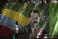 A man passes a mural of Venezuelan President Nicolas Maduro in Caracas, Venezuela, on July 22, 2020. (AP Photo/Ariana Cubillos)