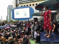 A woman addresses an anti-government gathering attended by hundreds of people, on Aug. 8, 2020, in Bangkok, Thailand. (AP Photo/Jerry Harmer)