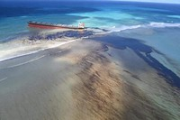 This photo taken and provided by Georges de La Tremoille of Mu Press shows oil leaking from the MV Wakashio, a bulk carrier ship that recently ran aground off the southeast coast of Mauritius, on Aug. 7, 2020. (Georges de La Tremoille/MU press via AP)