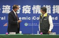 U.S. Health and Human Services Secretary Alex Azar, left, greets Taiwanese Minister of Health and Welfare Chen Shih-chung after the signing ceremony for a memorandum of understanding at the Central Epidemic Command Center in Taipei, Taiwan, on Aug. 10, 2020. (AP Photo/Chiang Ying-ying)