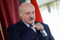 Belarusian President Alexander Lukashenko walks to cast his ballot at a polling station during the presidential election in Minsk, Belarus, on Aug. 9, 2020. (AP Photo/Sergei Grits)
