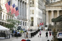 People walk by the New York Stock Exchange, left, on July 21, 2020. Wall Street is drifting in early trading on Aug. 10, after President Donald Trump announced several stopgap moves to aid the economy. (AP Photo/Mark Lennihan)