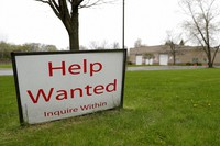 In this May 5, 2020 file photo, a help wanted sign shows at Illinois Air Team Test Station in Lincolnshire, Ill. (AP Photo/Nam Y. Huh)