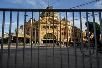 A cyclists passes an empty Flinders Street Station during lockdown due to the continuing spread of the coronavirus in Melbourne, on Aug. 6, 2020. (AP Photo/Andy Brownbill)