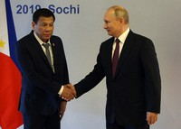 In this Oct. 3, 2019 file photo, Russian President Vladimir Putin, right, greets President of the Philippines Rodrigo Duterte, left, during their talks prior to the Annual Meeting of Valdai International Discussion Club at mountain resort of Krasnaya Polyana in Sochi, Russia. (Getty/Kyodo)