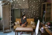 Rachelle Boumelhem sits in her damaged beauty salon in Beirut, Lebanon, on Aug. 10, 2020. (AP Photo/Felipe Dana)