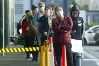People queue early morning outside a supermarket in Hobsonville, Auckland, as New Zealand prepares to move into Covid-19 Alert Level 3, on Aug. 12, 2020. (Dean Purcell/New Zealand Herald via AP)