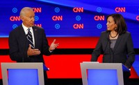 In this July 31, 2019, file photo, then-Democratic presidential candidate Sen. Kamala Harris, D-Calif., listens as Democratic presidential candidate former Vice President Joe Biden speaks during a Democratic presidential primary debate at the Fox Theatre in Detroit. Democratic presidential candidate former Vice President Joe Biden has chosen Harris as his running mate. (AP Photo/Paul Sancya)