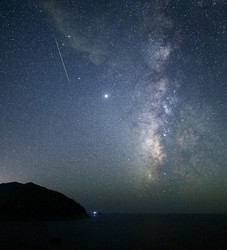 A shooting star from the Perseid meteor shower is seen near the Milky Way at Koganezaki cape in the town of Nishiizu, Shizuoka Prefecture, on Aug. 12, 2020. (Mainichi/Koichiro Tezuka)