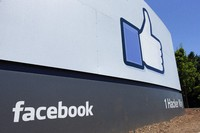 This July 16, 2013 file photo shows a sign at Facebook headquarters in Menlo Park, Calif. Beginning on Aug. 13, 2020. (AP Photo/Ben Margot)