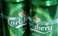This is Jan. 25, 2008 file photo of Carlsberg beer cans at a joint press conference by Heineken and Carlsberg to announce their joint bid to buy UK brewer Scottish & Newcastle (S&N), in London. (AP Photo/Sang Tan)