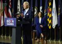 Democratic presidential candidate and former U.S. Vice President Joe Biden, joined by his running mate Sen. Kamala Harris, D-Calif., speaks during a campaign event at Alexis Dupont High School in Wilmington, Delaware, on Aug. 12, 2020. (AP Photo/Carolyn Kaster)