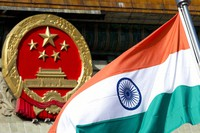 In this Oct. 23, 2013, file photo, an Indian national flag is flown next to the Chinese national emblem outside the Great Hall of the People in Beijing. (AP Photo/Andy Wong)