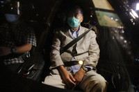 Hong Kong media tycoon and newspaper founder Jimmy Lai, sits in a car as he leaves a police station after being bailed out in Hong Kong, on Aug. 12, 2020. (AP Photo/Kin Cheung)