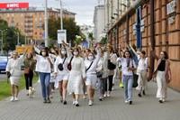 About 200 women march in solidarity with protesters injured in the latest rallies against the results of the country's presidential election in Minsk, Belarus, on Aug. 12, 2020. (AP Photo)