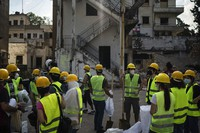 Volunteers from the American University of Beirut gather as they prepare to help remove debris in a neighborhood near the site of last week's explosion that hit the seaport of Beirut, Lebanon, on Aug. 13, 2020. (AP Photo/Felipe Dana)