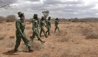 In this image made from video, female wildlife rangers from