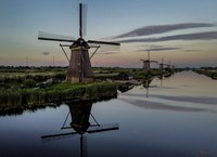 Windmills line a canal in Kinderdiijk, Netherlands, on Aug. 1, 2020. The five windmills are part of 19 mills built in the 18th century some 15 kms. (9.3 miles) south of Rotterdam. (AP Photo/Michael Probst)
