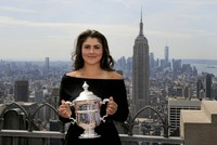 In this Sept. 8, 2019 file photo, Bianca Andreescu, of Canada, poses with the U.S. Open women's singles championship trophy at Top of the Rock in New York. (AP Photo/Charles Krupa)