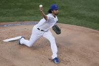 Chicago Cubs starting pitcher Yu Darvish delivers during the first inning of a baseball game against the Milwaukee Brewers on Aug. 13, 2020, in Chicago. (AP Photo/Jeff Haynes)
