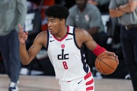 Washington Wizards' Rui Hachimura (8) gestures as he calls to teammates during the second half of an NBA basketball game on Aug. 11, 2020, in Lake Buena Vista, Florida. (AP Photo/Ashley Landis, Pool)