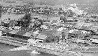 The town of Kajiki (the present-day city of Aira) in the southwestern Japan prefecture of Kagoshima is attacked in an air raid in this photo provided by Takao Imayoshi.