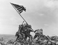 In this Feb. 23, 1945 file photo, U.S. Marines of the 28th Regiment, 5th Division, raise an American flag atop Mt. Suribachi, Iwo Jima, Japan. (AP Photo/Joe Rosenthal)