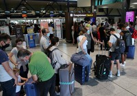 People queue to check-in at the Biarritz airport in southwestern France, on Aug.14, 2020. (AP Photo/Bob Edme)