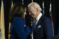 Democratic presidential candidate and former U.S. Vice President Joe Biden and his running mate Sen. Kamala Harris, D-Calif., pass each other as Harris moves to the podium to speak during a campaign event at Alexis Dupont High School in Wilmington, Delaware, on Aug. 12, 2020. (AP Photo/Carolyn Kaster)