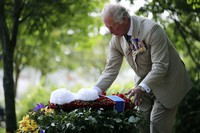 Britain's Prince Charles lays a wreath during the national service of remembrance marking the 75th anniversary of V-J Day at the National Memorial Arboretum in Alrewas, England, on Aug. 15, 2020. (Anthony Devlin/PA via AP)