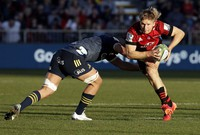 Crusaders Jack Goodhue, right, attempts to break the tackle of Highlanders Marino Mikaele-Tu'u during the Super Rugby Aotearoa rugby game between the Crusaders and the Highlanders in Christchurch, New Zealand, on Aug. 9, 2020. (AP Photo/Mark Baker)