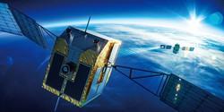 スカパーJSATが研究・開発中の宇宙ごみ除去衛星の想像図。宇宙ごみにレーザーを当てて軌道を変える スカパーJSAT提供