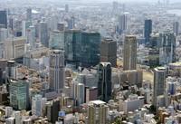 This file photo, taken in June 2015, from a Mainichi Shimbun helicopter, shows high-rise buildings in the area around the Umeda district of Osaka's Kita Ward. (Mainichi/Kentaro Ikushima)