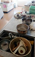 A cooking station at Healthcare Futaba, where people would make rice balls to distribute at the evacuation center, is seen with pots with rice still stuck to them and spatulas and dried out ingredients left in them as they were in March 2011, in the town of Futaba, Fukushima Prefecture, on Aug. 11, 2020. (Mainichi/Tomonari Takao)