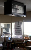 A clock that stopped shortly past 2:46 p.m., around the time of the Great East Japan Earthquake, and a calendar for March 2011, are seen in the government office at Futaba, Fukushima Prefecture, on Aug. 11, 2020. (Mainichi/Tomonari Takao)