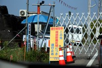 One of a number of signs around the town of Futaba in Fukushima Prefecture, which tell people they cannot enter because the area is a