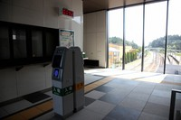 The ticket barrier at JR Futaba Station is seen with an electronic board indicating the current air radiation dose, in the town of Futaba, Fukushima Prefecture, on Aug. 11, 2020. (Mainichi/Tomonari Takao)