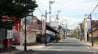 One of the town of Futaba's main streets is seen with dilapidated shops and devoid of people or cars, in Fukushima Prefecture, on Aug. 12, 2020. (Mainichi/Tomonari Takao)